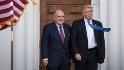 President-elect Donald Trump greets Rudy Giuliani at the clubhouse at Trump National Golf Club Bedminster in Bedminster Township, N.J. on Sunday, Nov. 20, 2016.