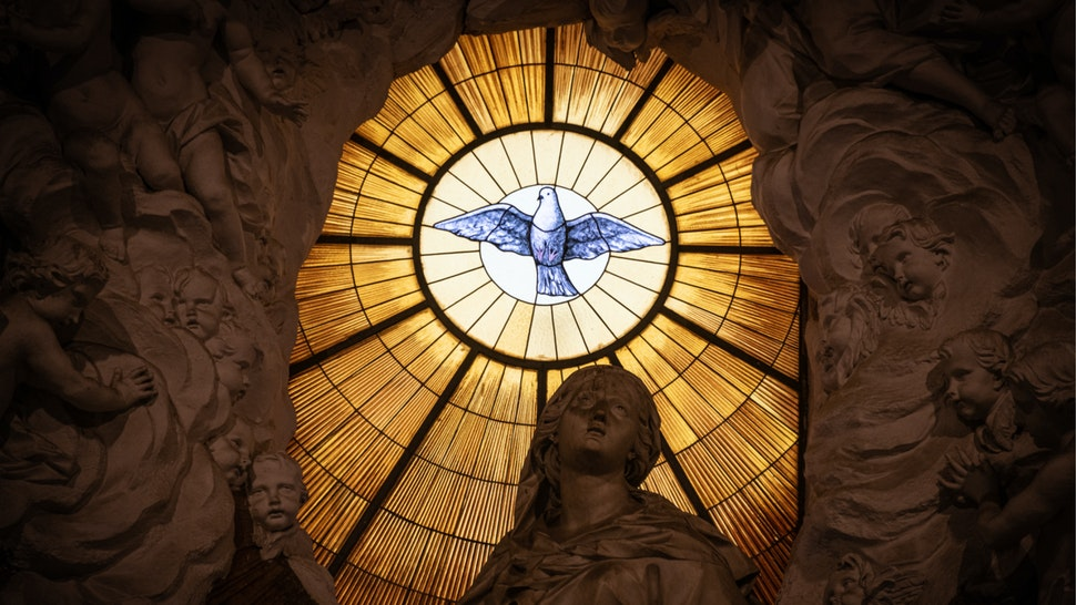 A stained glass window depicting a the Christian symbol of a white dove in the Cathedral of Naples, or Duomo di Napoli, in the Campania region of Italy on 29 December 2019.