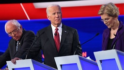 Democratic presidential hopefuls (from L) Vermont Senator Bernie Sanders, former US Vice President Joe Biden and Massachusetts Senator Elizabeth Warren take part in the fourth Democratic primary debate of the 2020 presidential campaign season co-hosted by The New York Times and CNN at Otterbein University in Westerville, Ohio on October 15, 2019.