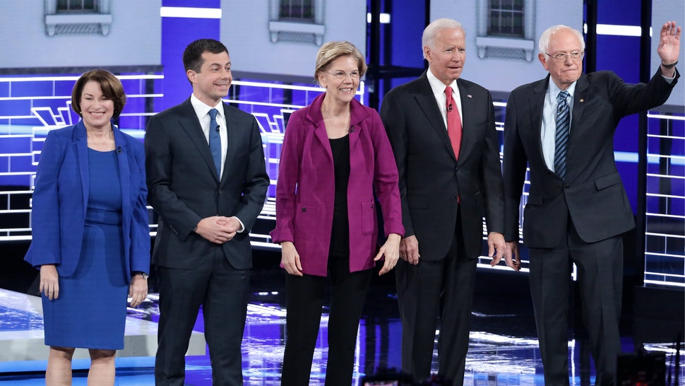 Democratic presidential candidates Sen. Amy Klobuchar (D-MN) (L), South Bend, Indiana Mayor Pete Buttigieg, Sen. Elizabeth Warren (D-MA), ormer Vice President Joe Biden, and Sen. Bernie Sanders (I-VT) greet the audience ahead of the Democratic Presidential Debate at Tyler Perry Studios November 20, 2019 in Atlanta, Georgia.