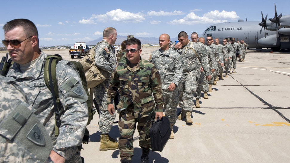 TUCSON, AZ - JULY 11: Members of the Kentucky National Guard 206th Engineer battalion arrive on a C-130 Hercules transport plane July 11, 2006 in Tucson, Arizona. One hundred members of the unit are here in support of Border Patrol agents maintaining the U.S./Mexican border. The two-week mission is part of President Bush's Operation Jump Start, which calls for 700 National Guard troops from around the country to help in securing the border in Arizona. The Kentucky Guard?s mission will be to build roads, fences and temporary vehicle barriers throughout the Tucson and Yuma sectors of the border.
