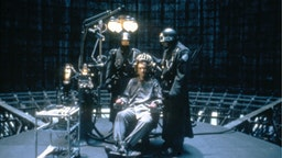 Welsh actor Jonathan Pryce on the set of Brazil, written and directed by Terry Gilliam.