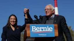 NEW YORK, NY - OCTOBER 19: Rep. Alexandria Ocasio-Cortez (D-NY) endorses Democratic presidential candidate, Sen. Bernie Sanders (I-VT) at a campaign rally in Queensbridge Park on October 19, 2019 in the Queens borough of New York City. This is Sanders' first rally since he paused his campaign for the nomination due to health problems.