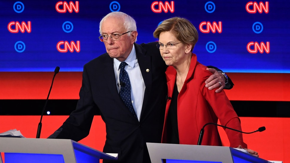 Democratic presidential hopefuls US senator from Vermont Bernie Sanders (L) and US Senator from Massachusetts Elizabeth Warren hug after participating in the first round of the second Democratic primary debate of the 2020 presidential campaign season hosted by CNN at the Fox Theatre in Detroit, Michigan on July 30, 2019.