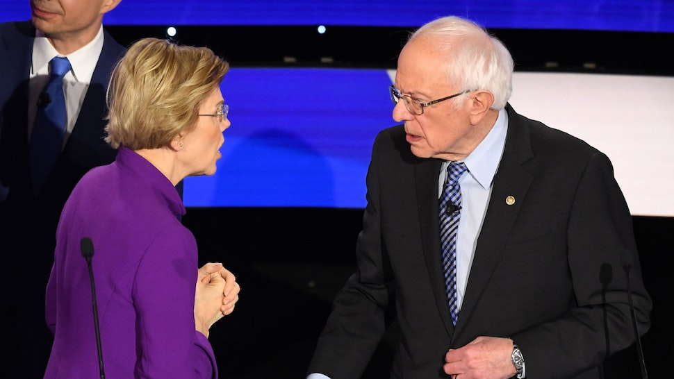 Democratic presidential hopeful Massachusetts Senator Elizabeth Warren and Vermont Senator Bernie Sanders speak after the seventh Democratic primary debate of the 2020 presidential campaign season co-hosted by CNN and the Des Moines Register at the Drake University campus in Des Moines, Iowa on January 14, 2020.