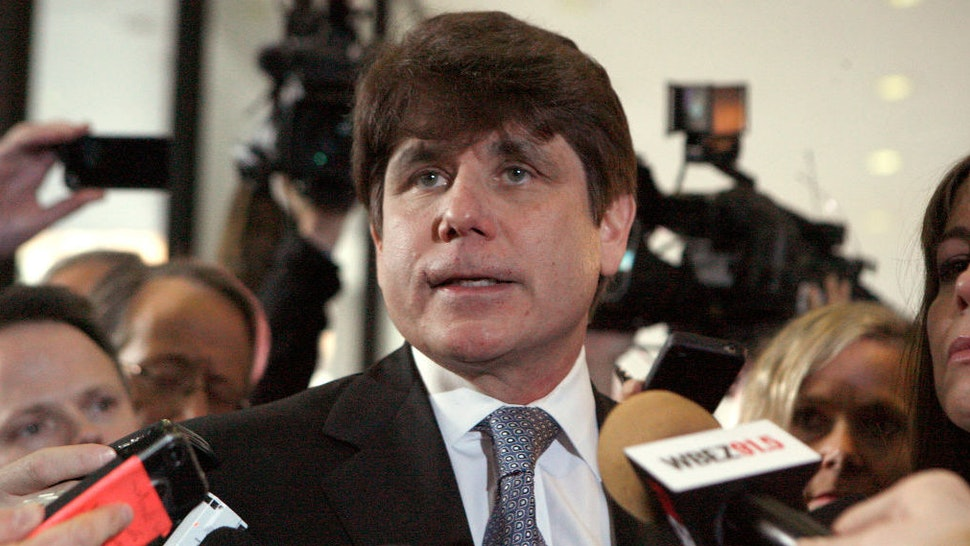 Former Illinois Governor Rod Blagojevich pauses while speaking to the media at the Dirksen Federal Building December 7, 2011 in Chicago, Illinois. Blagojevich was sentenced to 14 years in prison after he was found guilty of 17 public corruption charges. (Photo by Frank Polich/Getty Images)