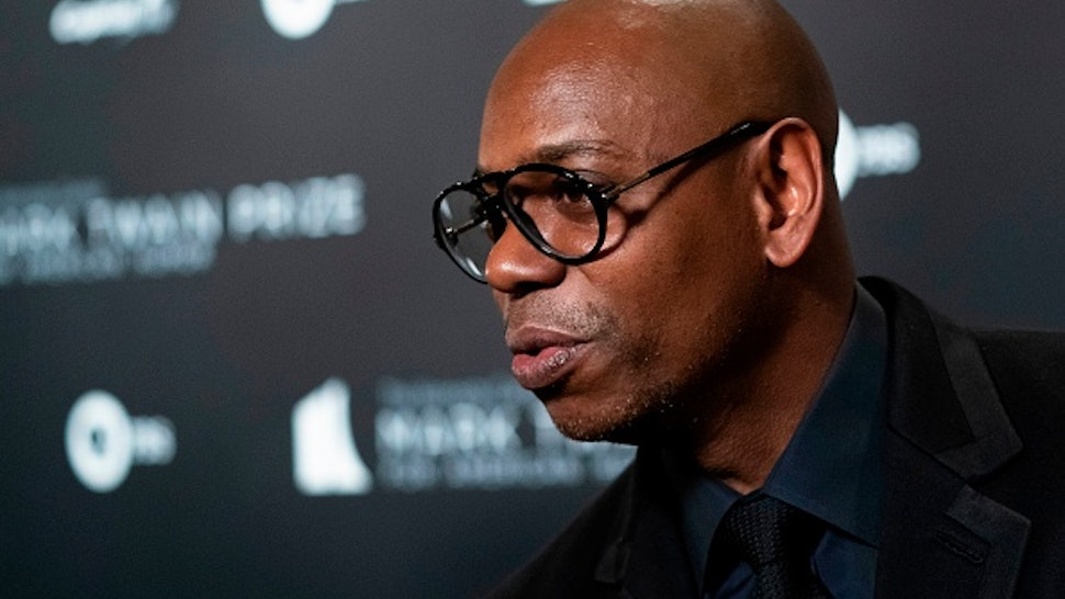 US comedian Dave Chappelle and recipient of the Mark Twain Award for American Humor arrives at the Kennedy Center for award ceremony on October 27, 2019 in Washington, D.C.