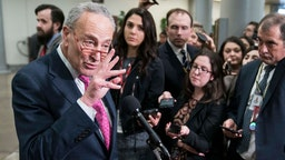 U.S. Minority Leader Chuck Schumer (D-NY) speaks to reporters near the Senate subway during a dinner break on the first day that senators have the opportunity to ask questions during impeachment proceedings against U.S. President Donald Trump on January 29, 2020 at the U.S. Capitol in Washington, DC. (Photo by Sarah Silbiger/Getty Images)