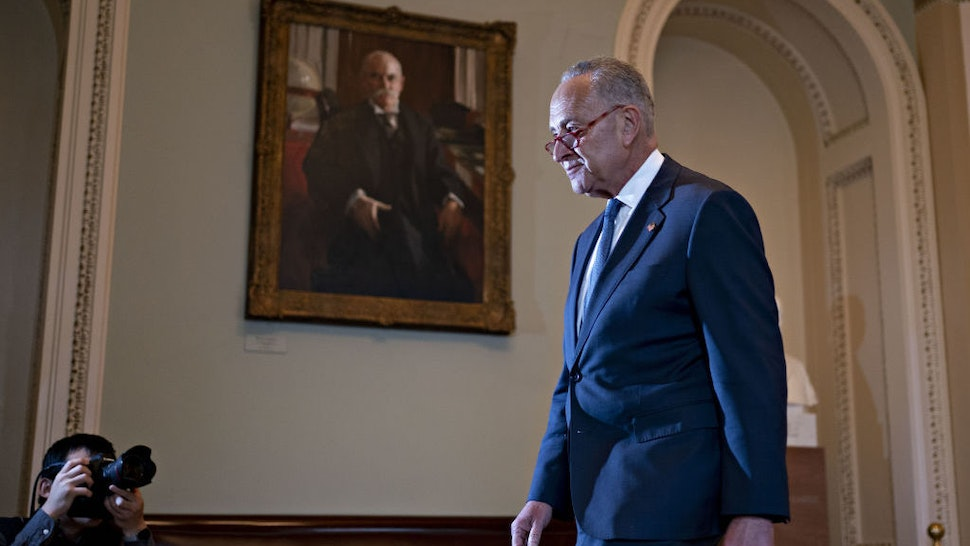 Senate Minority Leader Chuck Schumer, a Democrat from New York, walks to his office after speaking on the Senate floor at the U.S. Capitol in Washington, D.C., U.S., on Friday, Jan. 3, 2020. House Speaker Nancy Pelosi and Senate Majority Leader Mitch McConnell are locked in a stare-down over the terms of President Donald Trump's impeachment trial, which carries political risks for both sides if it continues deeper into January. Photographer: Andrew Harrer/Bloomberg