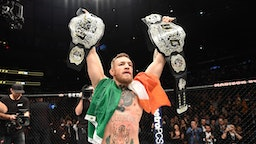 NEW YORK, NY - NOVEMBER 12: UFC lightweight and featherweight champion Conor McGregor of Ireland celebrates after defeating Eddie Alvarez in their UFC lightweight championship fight during the UFC 205 event at Madison Square Garden on November 12, 2016 in New York City.