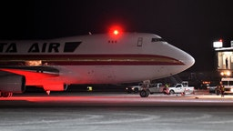 A Boeing 747-4B5(F), on a charter flight from Wuhan, China, arrives at Ted Stevens Anchorage International Airport on January 28, 2020 in Anchorage, Alaska. The U.S. government chartered the plane to evacuate U.S. citizens and diplomats from the U.S. consulate in Wuhan, China where the coronavirus outbreak began. (Photo by Lance King/Getty Images)