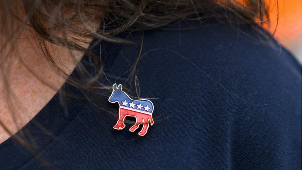 Donna Elms wears a Democrat donkey pin while lining up outside in advance of a campaign rally with former President Barack Obama, Pennsylvania Governor Tom Wolf, and Senator Bob Casey (D- PA) on September 21, 2018 in Philadelphia, Pennsylvania.
