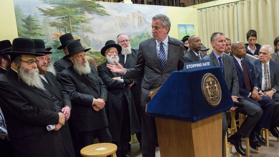 New York City Mayor Bill de Blasio, and the new New York police Commissioner Dermot Shea hold a press conference after meeting with Satmar Jewish community leaders to denounce the hate crime attack in Jersey City, December 12, 2019 in the Williamsburg neighborhood of Brooklyn, New York. (Photo by Andrew Lichtenstein/Corbis via Getty Images)