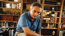Photo of Ralph Peters, retired army ofc now writing remarkable civil war novels under the name Owen Parry. Peters photographed in his library.