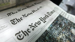 Copies of the New York Times sit for sale in a rack July 23, 2008 in New York City. The New York broadsheet announced it posted an 82 percent decline in second quarter profits as compared to last year.