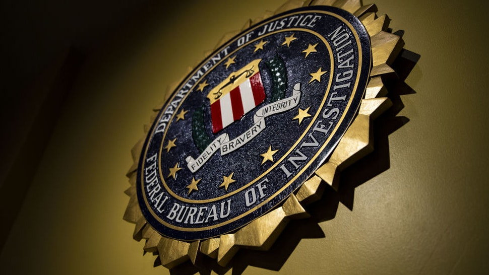 The seal of the Federal Bureau of Investigation (FBI) hangs on a wall before a news conference at the FBI headquarters in Washington, D.C., U.S., on Thursday, June 14, 2018.
