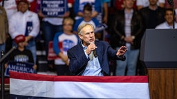 Greg Abbott, governor of Texas, speaks during a campaign rally with U.S. President Donald Trump for Senator Ted Cruz, not pictured, in Houston, Texas, U.S., on Monday, Oct. 22, 2018.