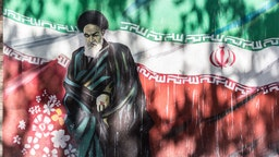 Revolutionary graffiti of Ruhollah Khomeini, the first post revolution Ayatollah with Iranian flag as a background on Taleqani Street in Tehran, the capital of Islamic Republic of Iran on September 27, 2018.
