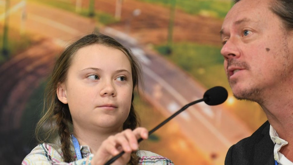 Swedish 15-year old climate activist, Greta Thunberg and her father Svante attend a press conference during the COP24 summit on climate change in Katowice, Poland, on December 04, 2018.
