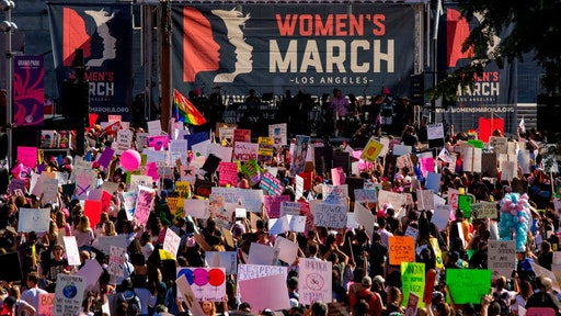 People rally at the Third Annual Women's March LA in downtown Los Angeles, California on January 19, 2019.