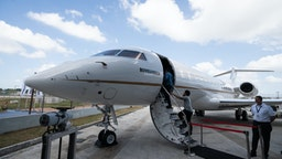 Attendees climb the airstair to a Bombardier Inc. Global 6000 business jet on display during a media event at Seletar Aerospace Heights in Singapore, on Wednesday, Feb. 27, 2019. Bombardier is more than doubling the size of its bond buybacks to as much as $1.83 billion after raising twice the amount initially expected in its new debtsaleon Thursday amid a red-hot junk-bond market. Photographer: Nicky Loh/Bloomberg via Getty Images