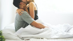 passionate couple is having sex on bed - stock photo