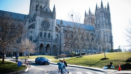 WASHINGTON, DC - JANUARY 25: People walk near Washington National Cathedral. Massachusetts Avenue Heights is a neighborhood in DC that is bounded to the north by Woodley Road, to the southwest by Massachusetts Avenue, to the east by 34th Street NW, and to the west by Wisconsin Avenue. (Photo by Sarah L. Voisin/The Washington Post via Getty Images)
