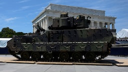 "A Bradley Fighting Vehicle is parked as preparations are made for the ""Salute to America"" Fourth of July event with US President Donald Trump at the Lincoln Memorial on the National Mall in Washington, DC, July 3, 2019, which will feature flyovers by the Blue Angels, an airplane used as Air Force One, as well as military demonstrations and a speech by Trump. (Photo by Andrew CABALLERO-REYNOLDS / AFP) (Photo credit should read ANDREW CABALLERO-REYNOLDS/AFP via Getty Images)"
