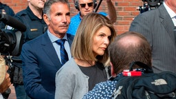 Actress Lori Loughlin and husband Mossimo Giannulli exit the Boston Federal Court house after a pre-trial hearing with Magistrate Judge Kelley at the John Joseph Moakley US Courthouse in Boston on August 27, 2019.