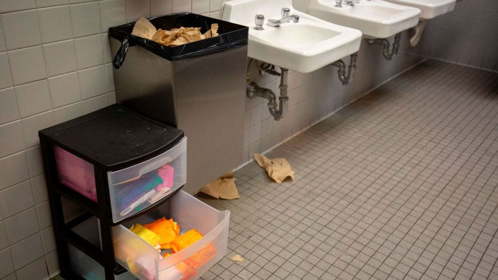 Free pads and tampons are seen in a bathroom at Justice High School in Falls Church, Virginia, on September 11, 2019.