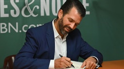 """Donald Trump Jr., signs his new Book """"Triggered: How the Left Thrives on Hate and Wants to Silence Us"""" at Barnes & Noble on 5th Avenue on November 5, 2019 in New York."""