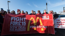 McDonald's employees at Wandsworth branch stage a walkout demanding £15 an hour minimum wage, union recognition, choice of guaranteed working hours and abolition of zero hour contracts as part of coordinated strike action by workers of six London McDonald's stores on 12 November, 2019 in Lodnon, England.