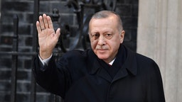 LONDON, ENGLAND - DECEMBER 03: President of Turkey, Recep Tayyip Erdogan arrives for a meeting with Prime Minister Boris Johnson at number 10 Downing Street on December 3, 2019 in London, England. France and the UK signed the Treaty of Dunkirk in 1947 in the aftermath of WW2 cementing a mutual alliance in the event of an attack by Germany or the Soviet Union. The Benelux countries joined the Treaty and in April 1949 expanded further to include North America and Canada followed by Portugal, Italy, Norway, Denmark and Iceland. This new military alliance became the North Atlantic Treaty Organisation (NATO). The organisation grew with Greece and Turkey becoming members and a re-armed West Germany was permitted in 1955. This encouraged the creation of the Soviet-led Warsaw Pact delineating the two sides of the Cold War. This year marks the 70th anniversary of NATO.