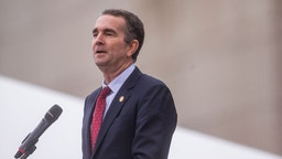 Virginia Gov. Ralph Northam speaks during an unveiling ceremony for Rumors of War, a statue by artist Kehinde Wiley, at the Virginia Museum of Fine Arts on December 10, 2019 in Richmond, Virginia.