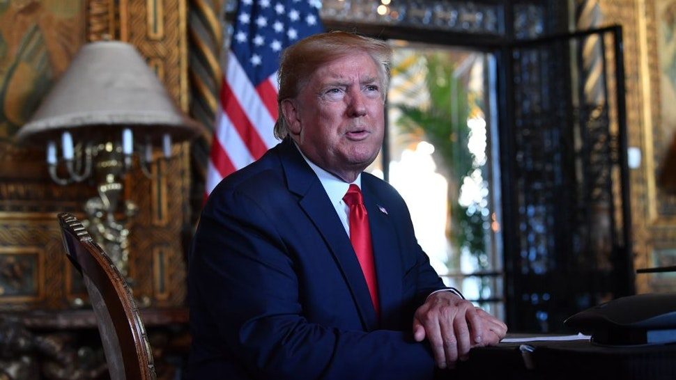 US President Donald Trump answers questions from reporters after making a video call to the troops stationed worldwide at the Mar-a-Lago estate in Palm Beach Florida, on December 24, 2019.