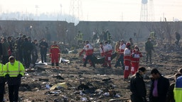TEHRAN, IRAN - JANUARY 08: Search and rescue works are conducted at site after a Boeing 737 plane belonging to a Ukrainian airline crashed near Imam Khomeini Airport in Iran just after takeoff with 180 passengers on board in Tehran, Iran on January 08, 2020. All 167 passengers and nine crew members on an Ukrainian 737 plane that crashed near Iran's capital Tehran early Wednesday have died, according to a state official.