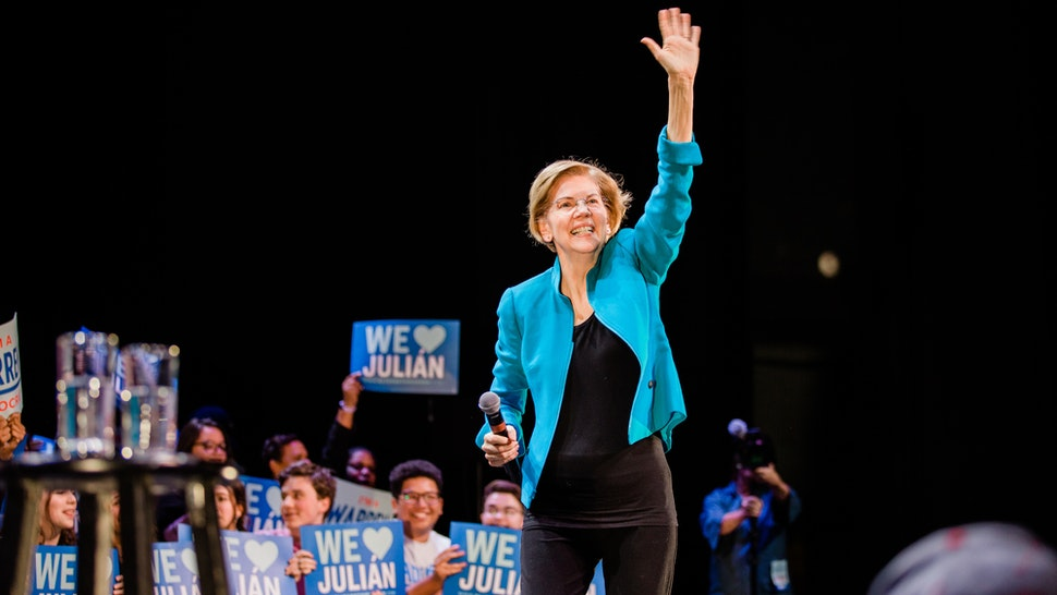 Senator Elizabeth Warren, a Democrat from Massachusetts and 2020 presidential candidate, waves to attendees during a campaign event in the Brooklyn Borough of New York, U.S., on Tuesday, Jan. 7, 2020. Warren rolled out a plan Tuesday to restore bankruptcy protections repealed in a 2005 law championed by Joe Biden, taking an implicit shot at the Democratic presidential front-runner just weeks before the first nominating contests next month. Photographer: Gabriela Bhaskar/Bloomberg via Getty Images