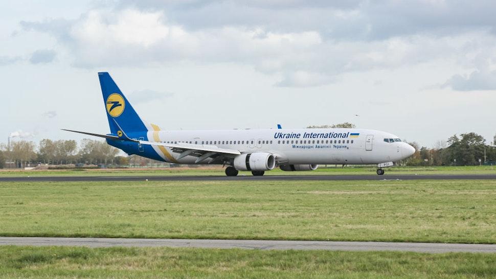 Ukraine International Airlines UIA Boeing 737 aircraft as seen landing at Amsterdam Schiphol AMS EHAM Airport.