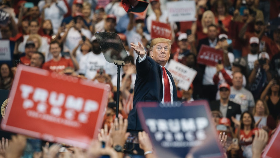 President Donald Trump throws a hat to the crowd during a 'Homecoming' rally in Sunrise, Florida, U.S., on Tuesday, Nov. 26, 2019. Monday, January 20, 2020, marks the third anniversary of U.S. President Donald Trump's inauguration.