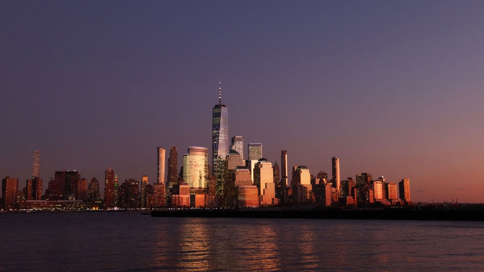 JERSEY CITY, NJ - DECEMBER 19 The sun reflects off the windows of One World Trade Center and the skyline of lower Manhattan in New York City on December 19, 2019 in Jersey City, New Jersey.