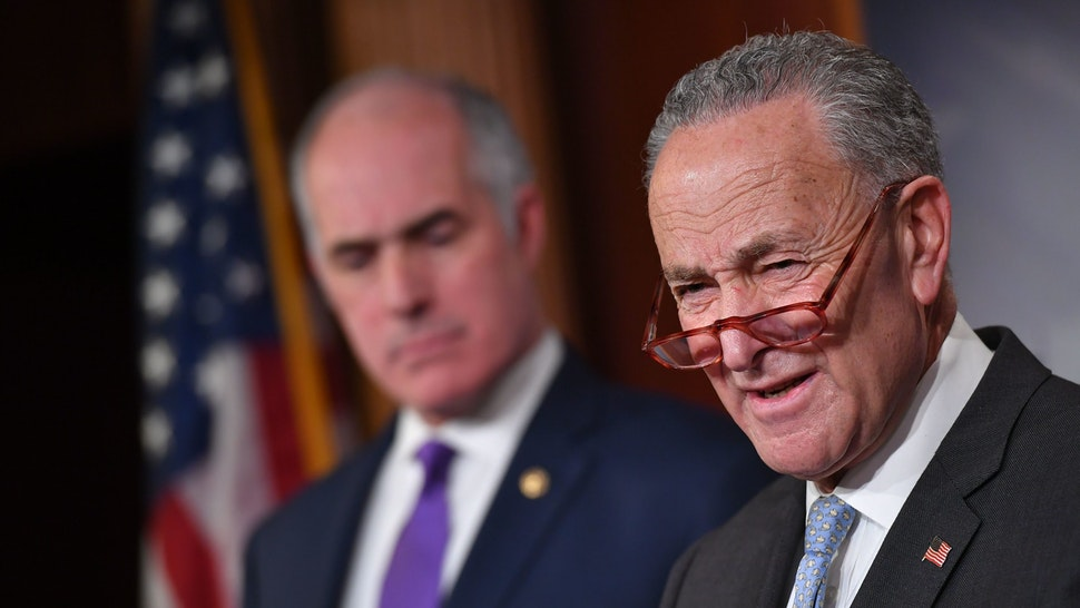 """US Senate Minority Leader Chuck Schumer, Democrat of New York; with Senator Bob Casey (L), Democrat of Pennsylvania; speaks to the press ahead of opening statement in the impeachment trial of US President Donald Trump, at the US Capitol in Washington DC, on January 23, 2020. - Democrats accused Trump at his historic Senate impeachment trial of seeking to cheat to ensure re-election in November, and called for """"courage"""" by the president's fellow Republicans while considering the case against him. (Photo by MANDEL NGAN / AFP) (Photo by MANDEL NGAN/AFP via Getty Images)"""