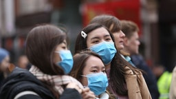 """London Chinatown entered the Chinese new year (""""year of the rat"""") in the shadow of coronavirus with pedestrians covering their faces with sanitary masks but celebrations went on in London, England on January 26, 2020."""