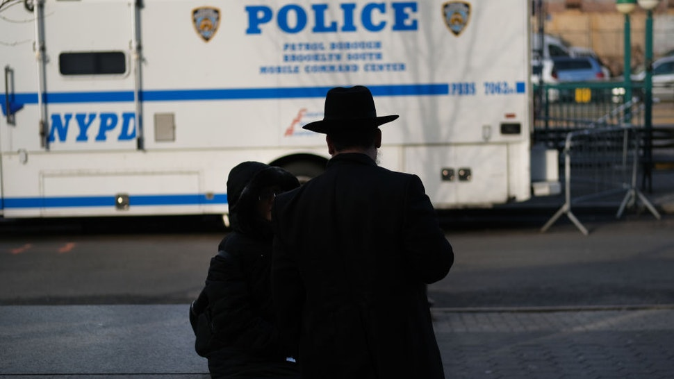 NEW YORK, NEW YORK - DECEMBER 31: People walk through the Orthodox Jewish section of the Crown Heights neighborhood in Brooklyn on December 31, 2019 in New York City. Five Orthodox Jews were stabbed at a synagogue on Saturday evening in the upstate New York town of Monsey. Tensions remain high in Jewish communities following a series of attacks and incidents in recent weeks.