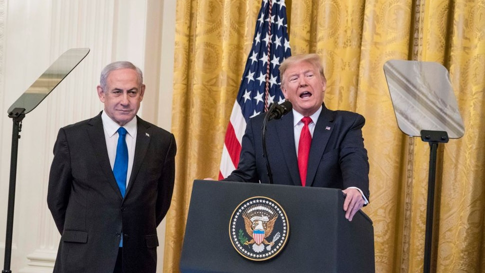U.S. President Donald Trump and Israeli Prime Minister Benjamin Netanyahu participate in a joint statement in the East Room of the White House on January 28, 2020 in Washington, DC.
