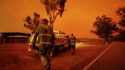EAST GIPPSLAND, AUSTRALIA - JANUARY 04: Department of Environment, Land, Water and Planning crew get into their vehicle to respond to a call on January 04, 2020 in Double Bridges, Australia. Two people are dead and 28 remain missing following bushfires across the East Gippsland area, with Victorian premier Daniel Andrews declaring a state of disaster in the region. Thousands of people remain stranded in the coastal town of Mallacoota and are being evacuated by navy ships to Melbourne. (Photo by Darrian Traynor/Getty Images)