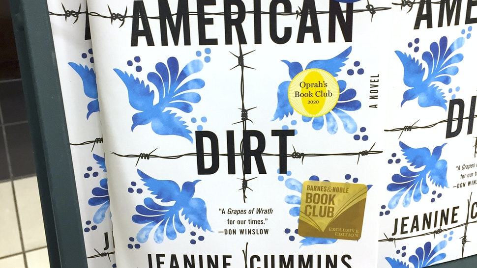 "Photo shows ""American Dirt"" books sitting on a rack at a bookstore in New York on January 30, 2020. - The book by American author Jeanine Cummins tells the story of a Mexican woman who escaped as an illegal immigrant to the United States with her son. The publisher canceled the scheduled book tour amidst controversy and safety concerns. (Photo by Laura BONILLA CAL / AFP) (Photo by LAURA BONILLA CAL/AFP via Getty Images)"