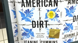 """Photo shows """"American Dirt"""" books sitting on a rack at a bookstore in New York on January 30, 2020. - The book by American author Jeanine Cummins tells the story of a Mexican woman who escaped as an illegal immigrant to the United States with her son. The publisher canceled the scheduled book tour amidst controversy and safety concerns. (Photo by Laura BONILLA CAL / AFP) (Photo by LAURA BONILLA CAL/AFP via Getty Images)"""