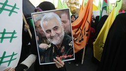 Iranian protesters hold a portrait of the commander of the Iranian Revolutionary Guard's Quds Force, Gen. Qassem Soleimani, during a demonstration in the capital Tehran on December 11, 2017, to denounce US President Donald Trump's declaration of Jerusalem as Israel's capital. (Photo by ATTA KENARE / AFP) (Photo by ATTA KENARE/AFP via Getty Images)