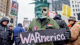 HERALD SQUARE, NEW YORK, UNITED STATES - 2018/04/15: Hundreds took to the streets as antiwar and social justice groups organized a demonstration in New York City, with a rally at Herald Square and march to Trump Tower as part of national regional spring actions throughout the country against the US bombing of Syria and opposing endless U.S. wars. (Photo by Erik McGregor/Pacific Press/LightRocket via Getty Images)