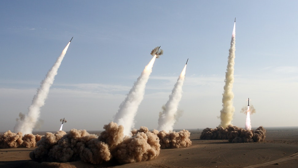 Iran's Revolutionary Guards fire test missiles during the first phase of military manoeuvres in the central desert outside the holy city of Qom, 02 November 2006. The Islamic republic fired its longer-range missile on exercise for the first time today as it began 10 days of war games amid a mounting standoff with the West over its nuclear programme.
